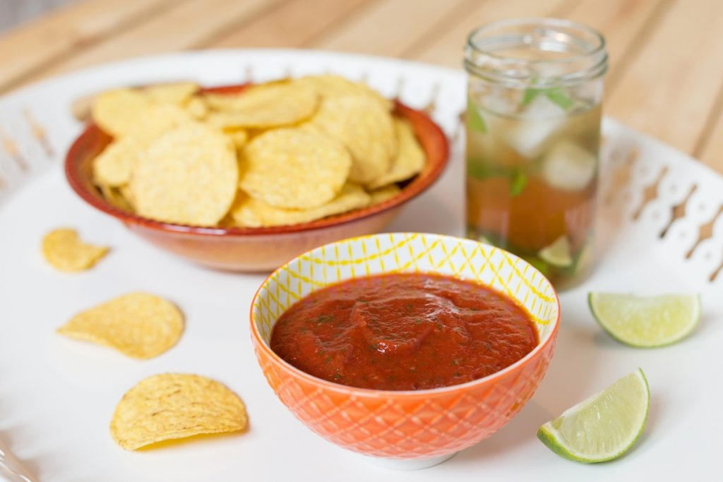 A blended salsa infused with garlic is the ultimate dip for your nacho chips.