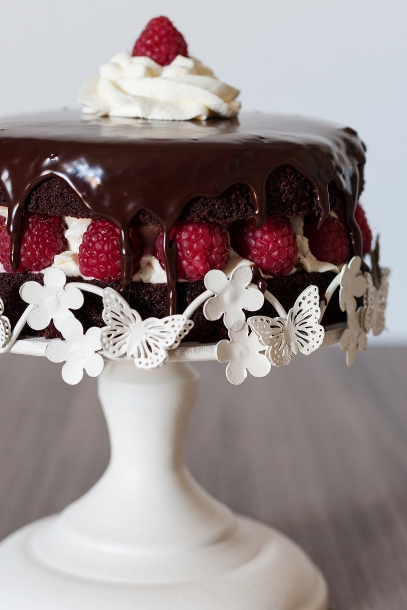 chocolate cake with cream and raspberries