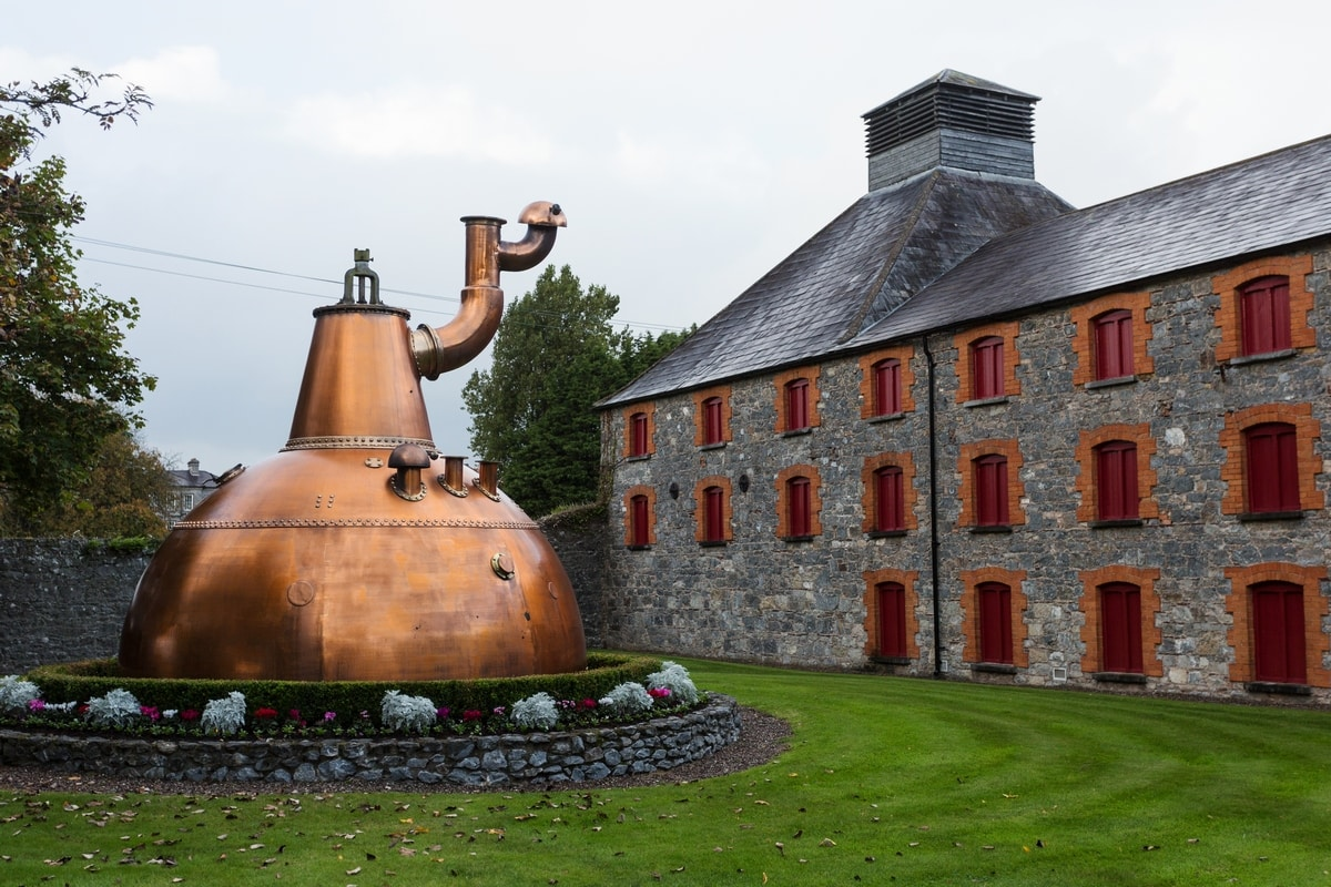 Jameson Experience distillery in Midleton, old pot still on display outside.