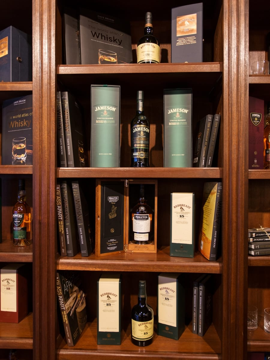 Irish whiskey bottles on a shelf.