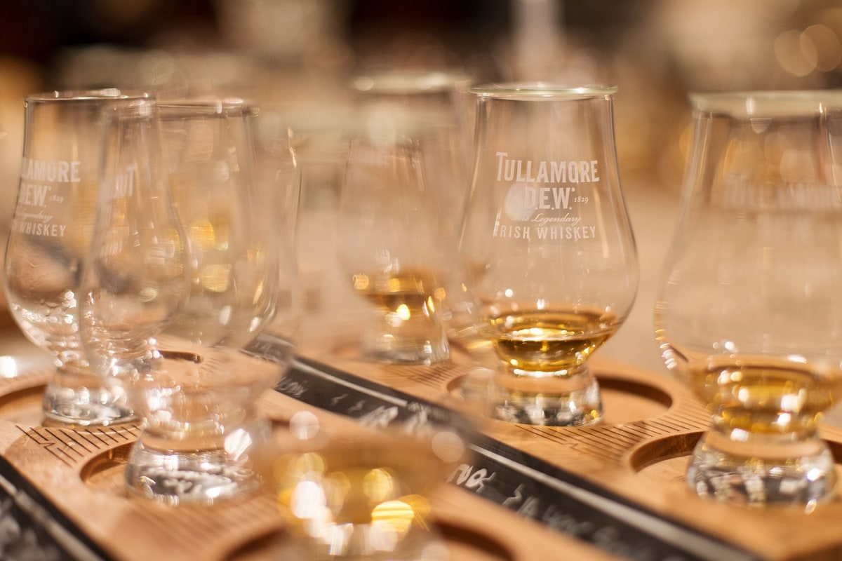 Whiskey glasses filled with samples.