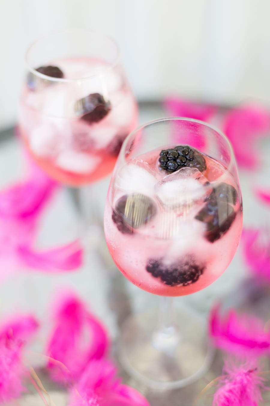 Blackberry gin and tonic with pink tonic water
