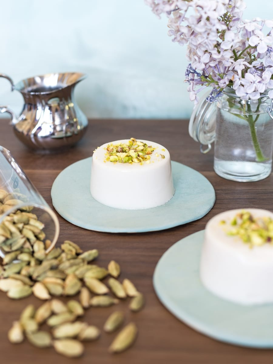 Coconut cardamom dessert with ground pistachio on top.