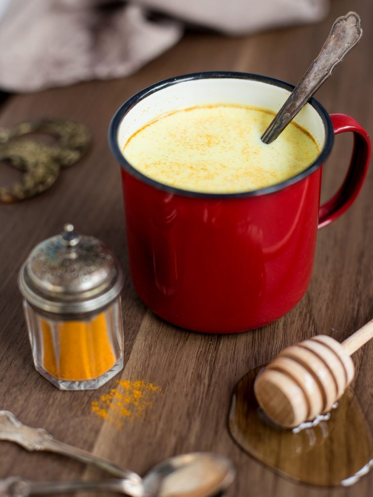 Hot milk with honey, rum and turmeric
