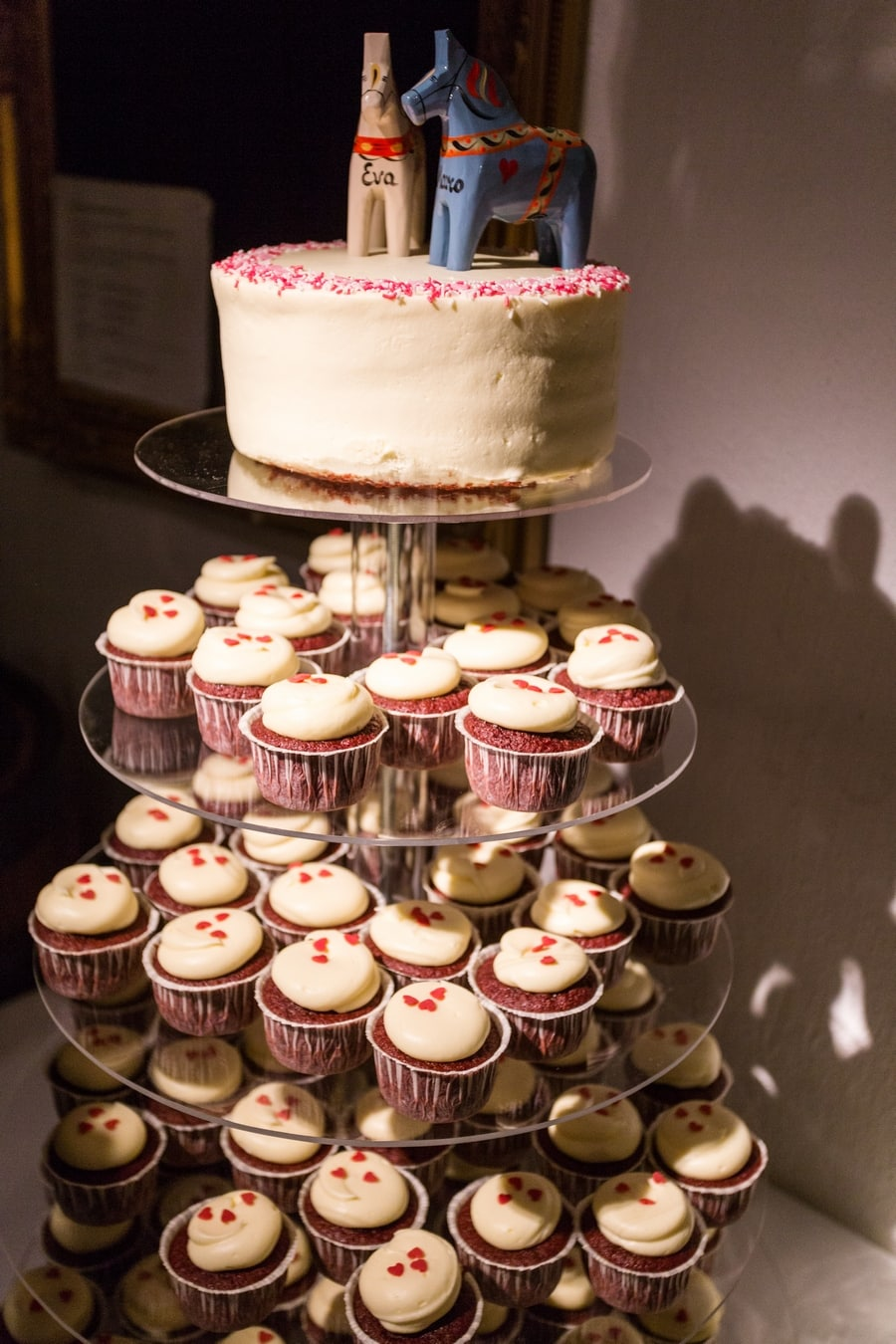 My wedding reception: the wedding cake made of red velvet cupcakes with dala horses on top