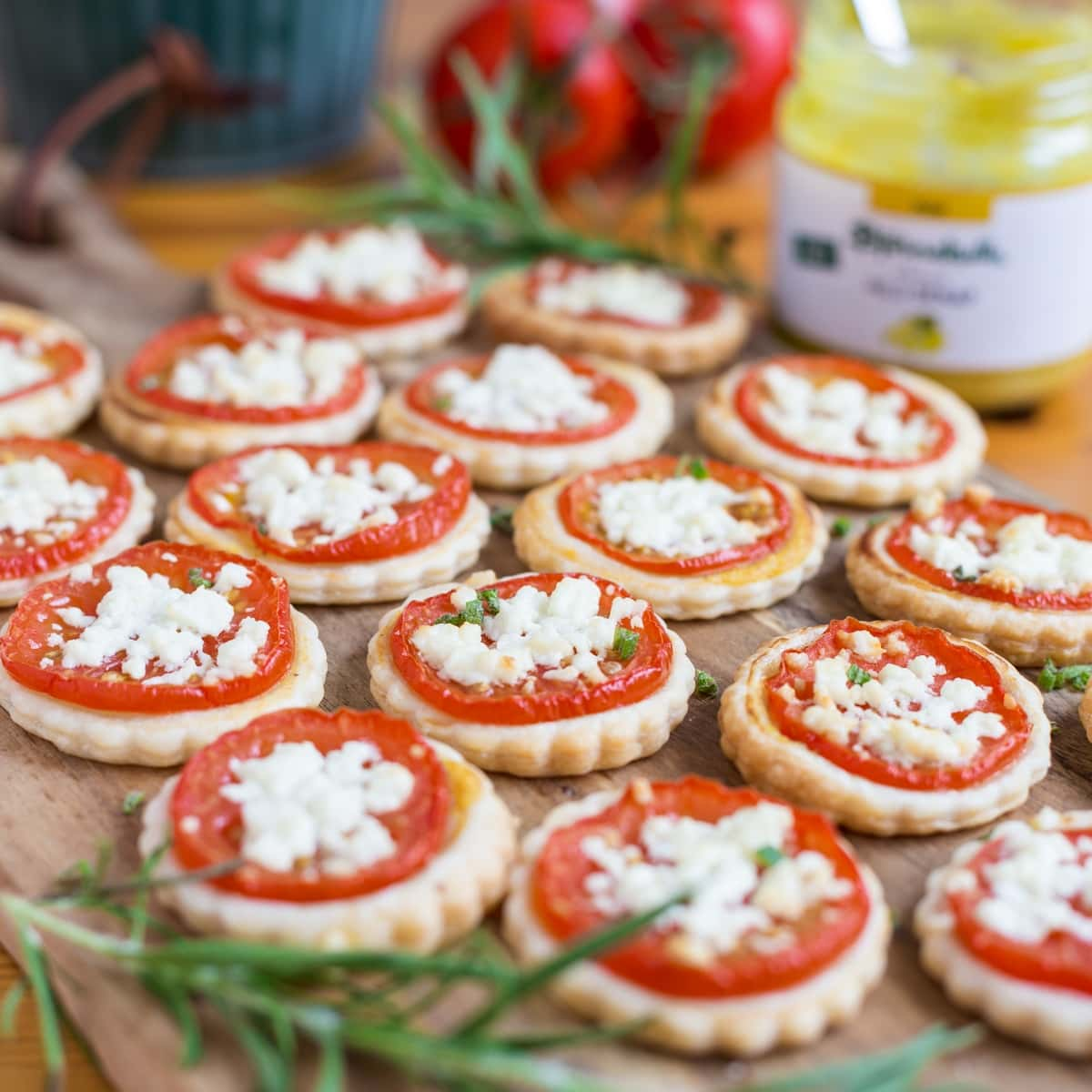 Tomato mustard mini tarts, ingredients in the background.