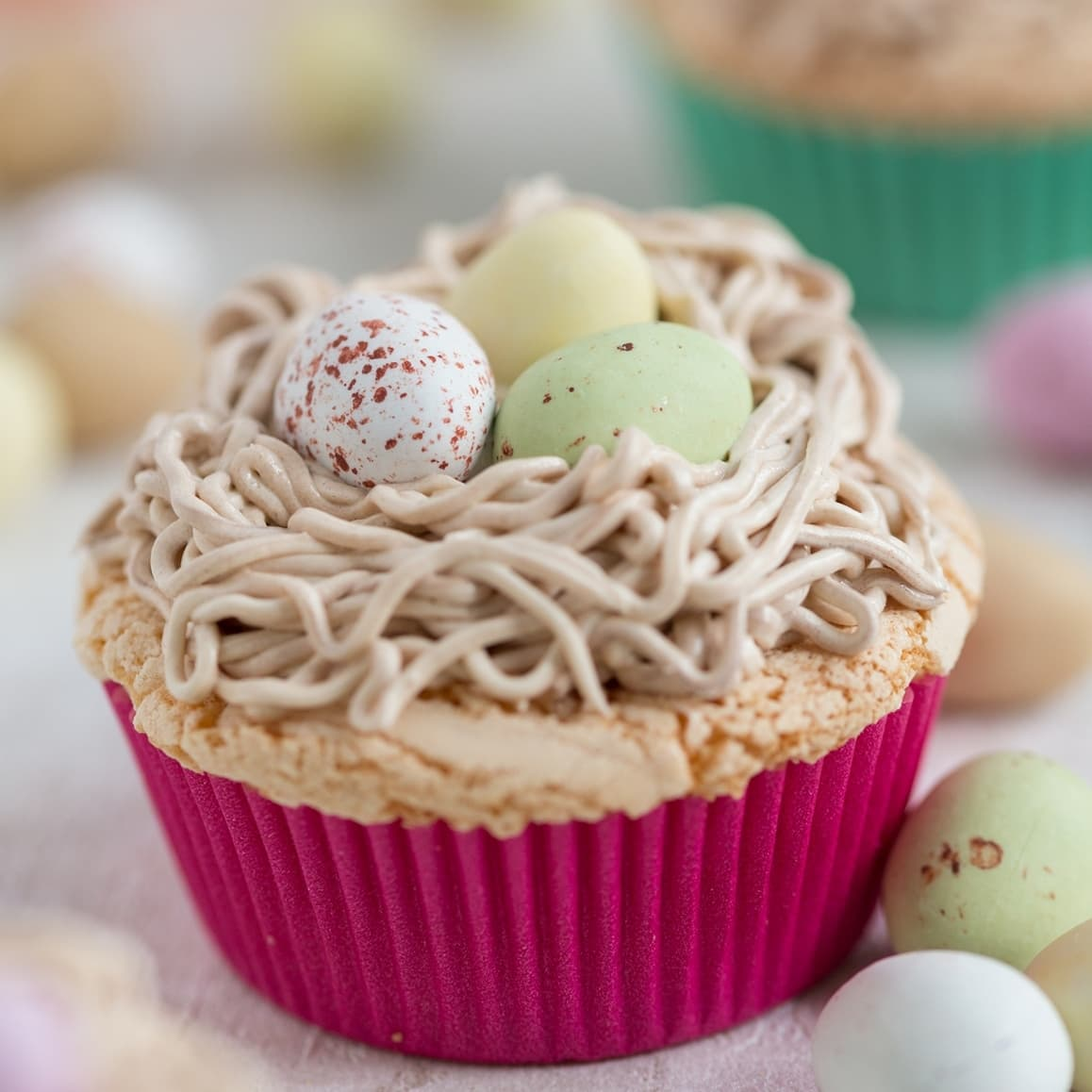 Bird's nest cupcake. Egg cake topped with a buttercream nest and egg chocolates.