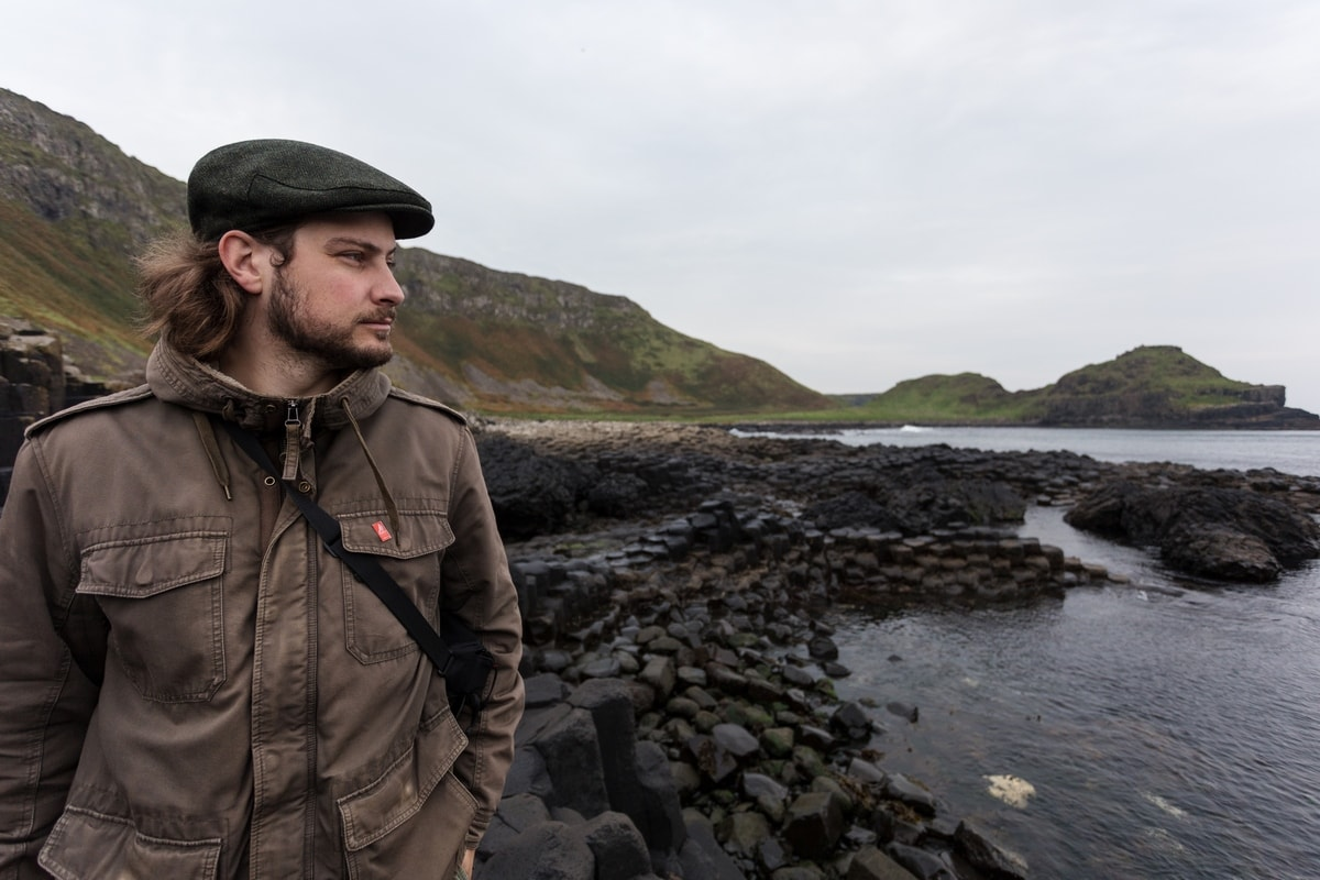 man with Irish hat at giant's causeway