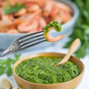 A small bowl with nordic pesto and a large bowl filled with smoked shrimp.