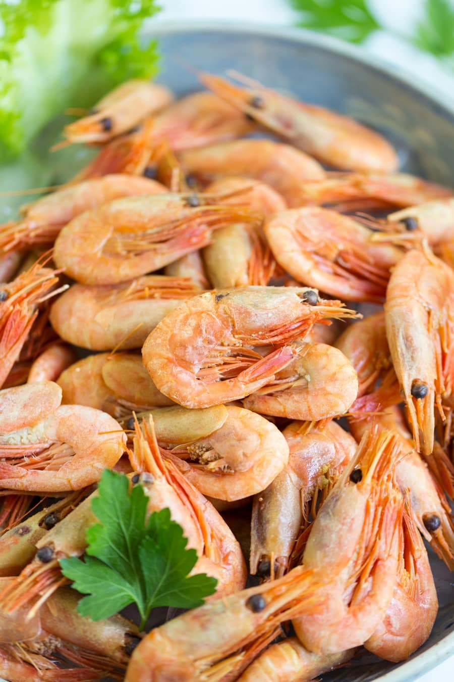 Closeup of smoked shrimps in a bowl.
