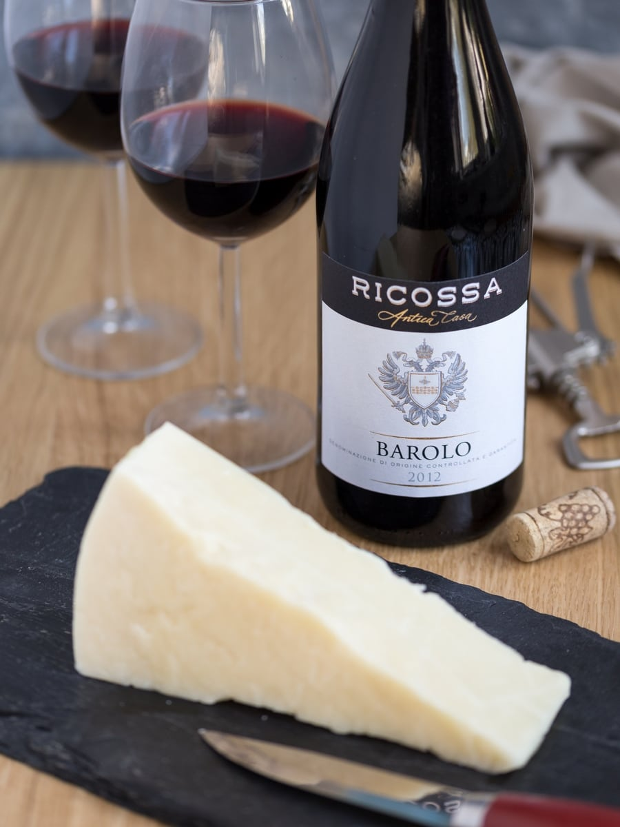 Bottle of Barolo red wine and chunk of Pecorino cheese.