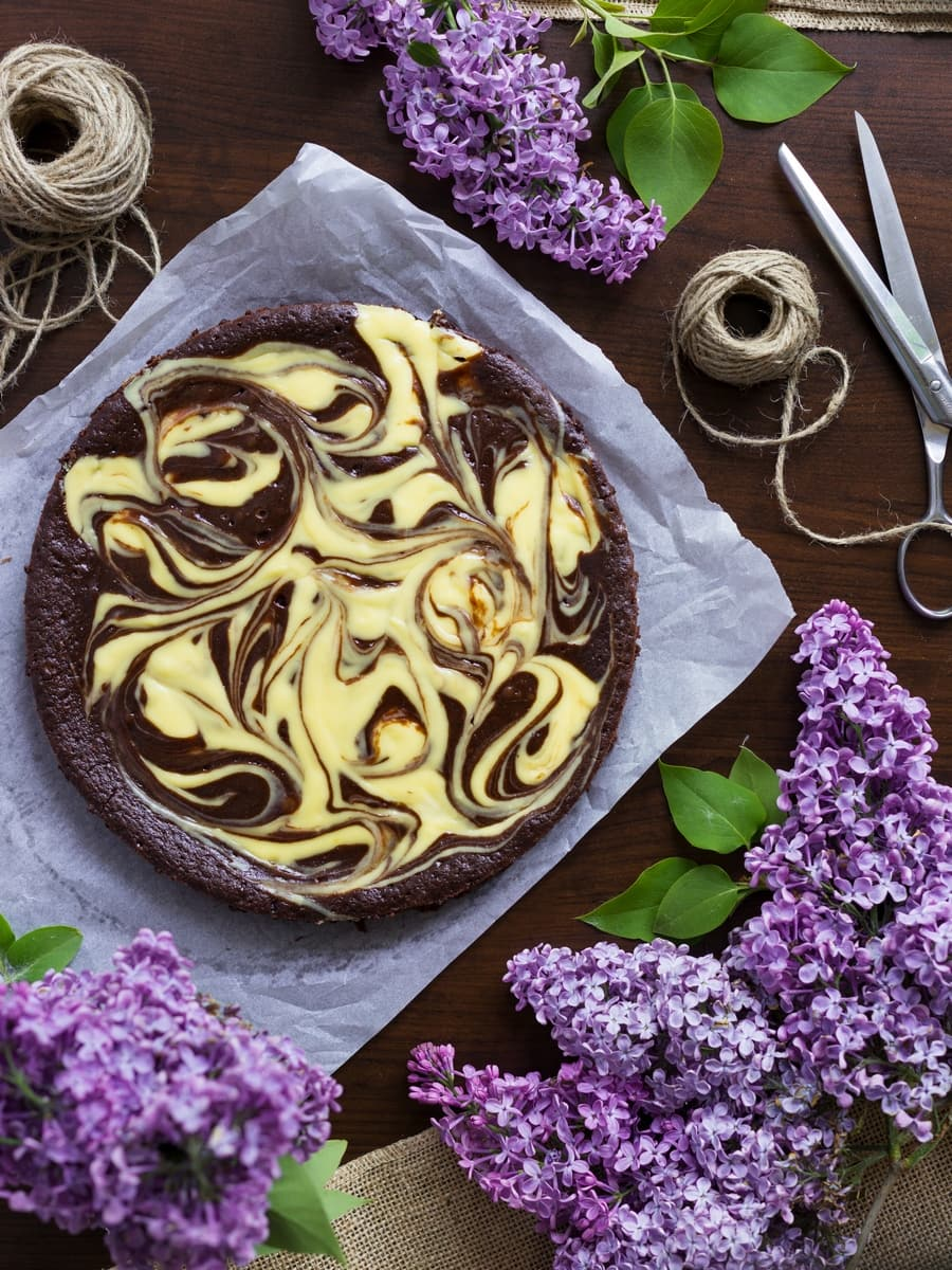 Cheesecake kladdkaka seen from above. Chocolate cake with a cheesecake swirl on top.