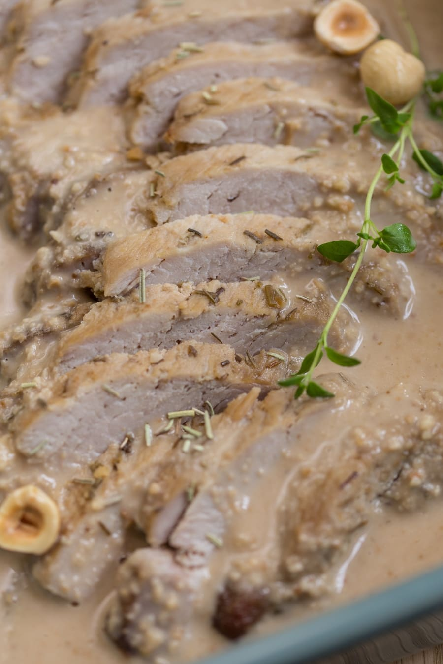 Baked pork loin in hazelnut sauce closeup.