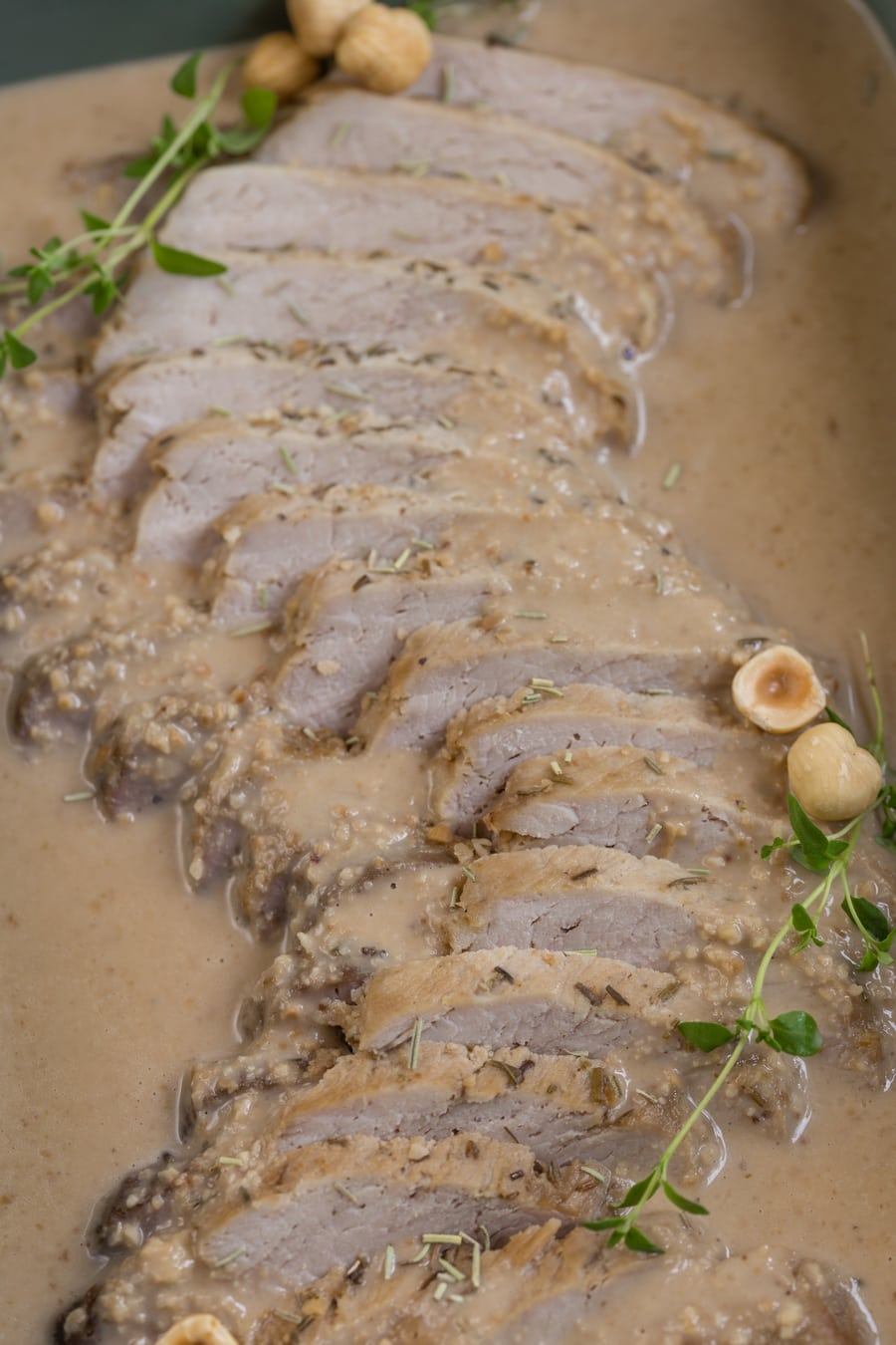 Baked pork loin in hazelnut gravy.