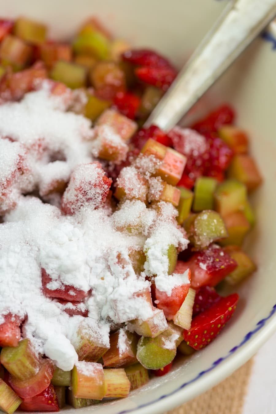 Strawberry rhubarb crisp base: sugar and starch added to diced fruits.