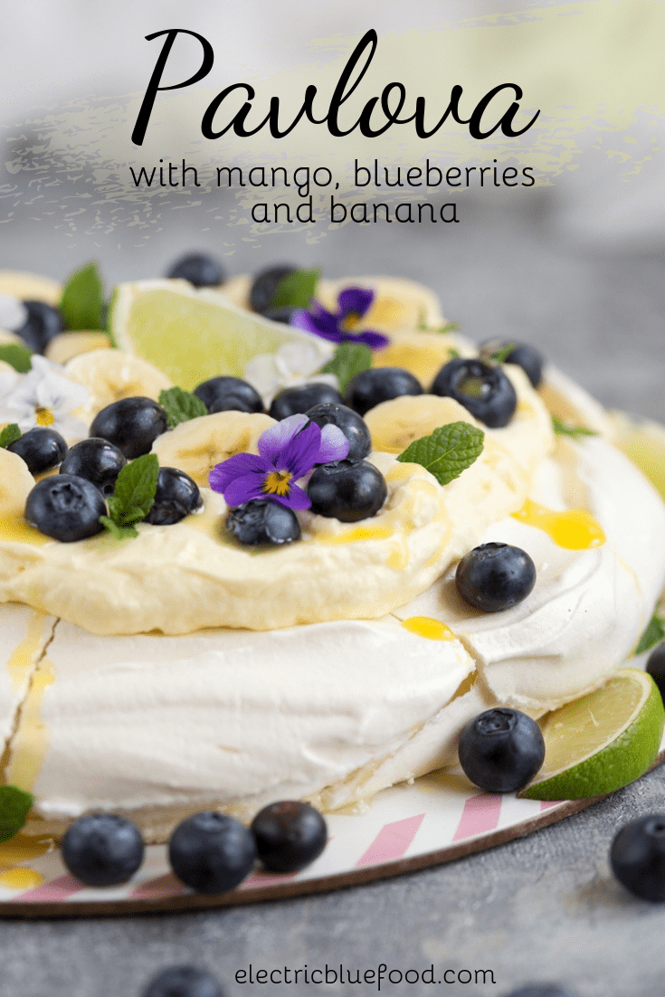 Pavlova with mango, blueberries and banana. A blue and yellow topping for this Australian cake.