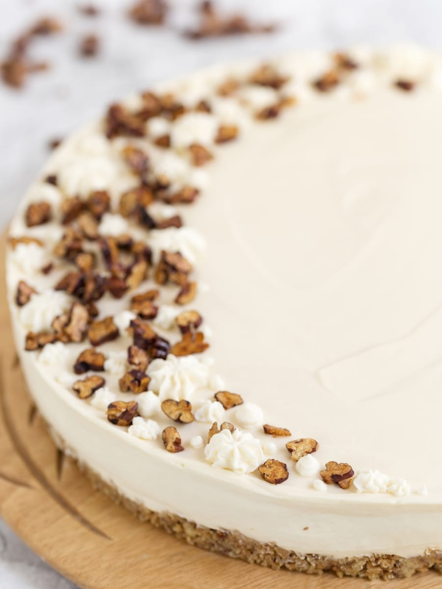 Closeup of roasted pecans on maple no-bake cheesecake.