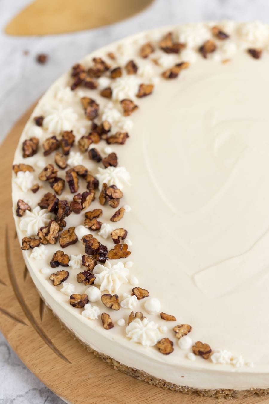 Roasted candied pecans and maple cream on cake.