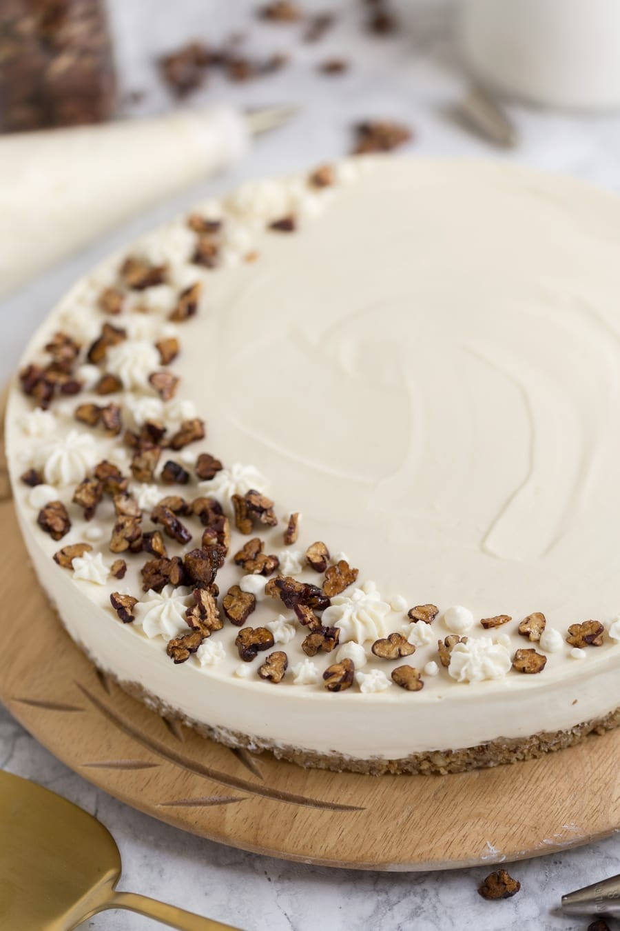 No-bake maple syrup cheesecake on wooden plate.
