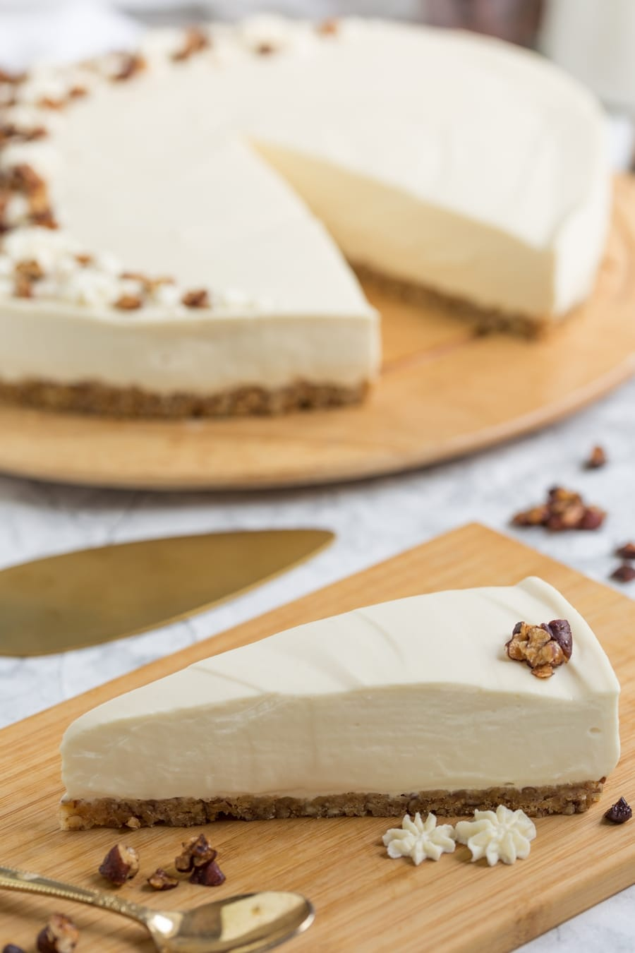 Cheesecake slice with candied pecans.