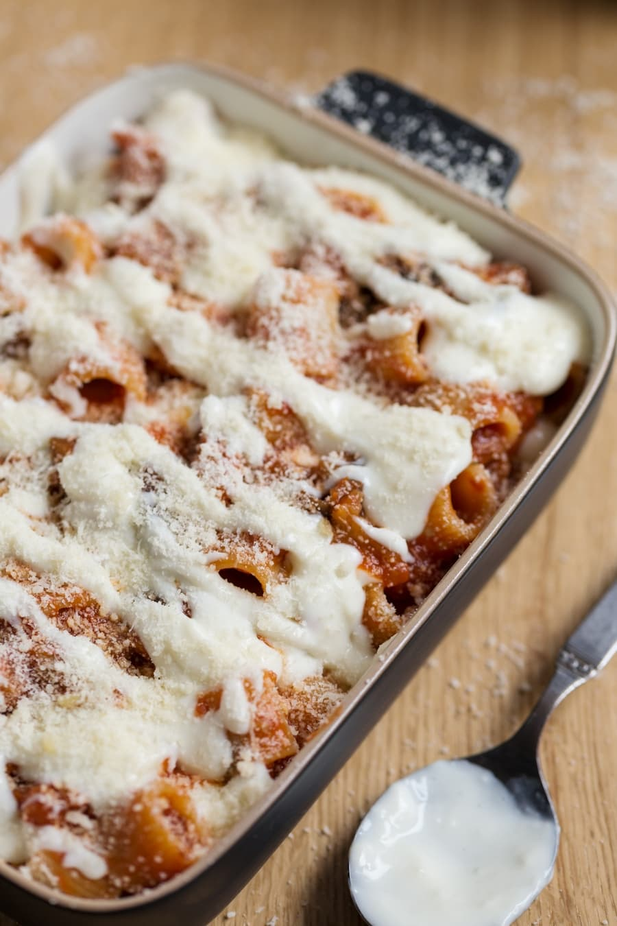 Uncooked eggplant pasta bake in casserole.