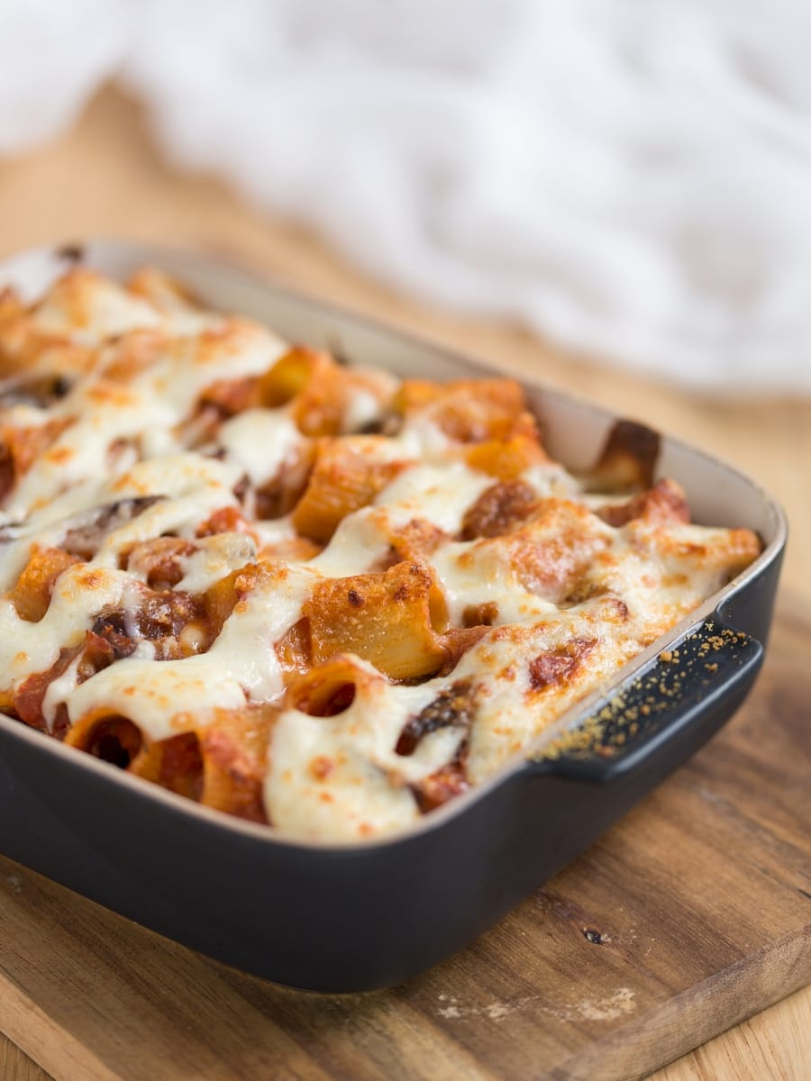 Baked pasta casserole sprinkled with parmesan.