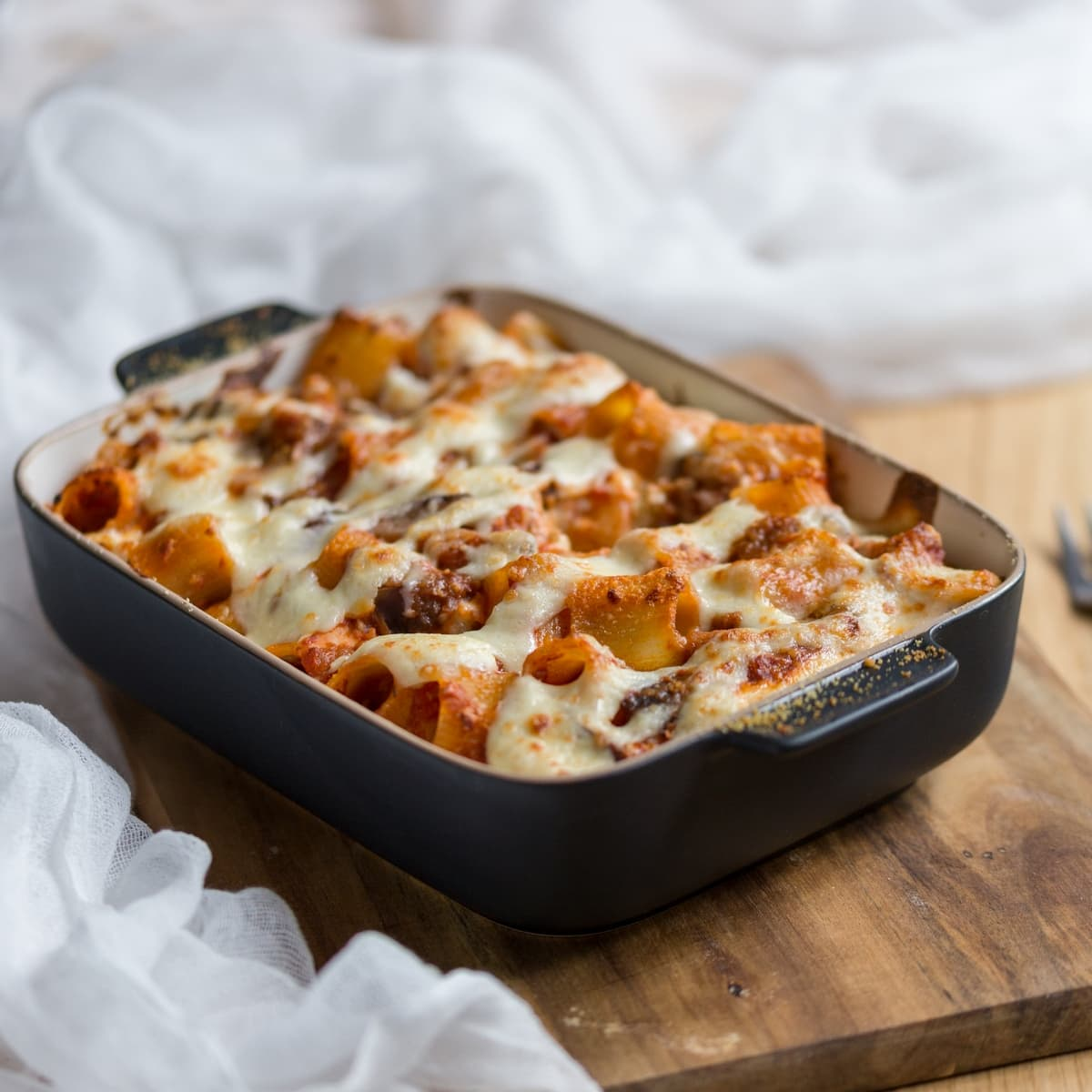 Eggplant pasta bake served in casserole dish.