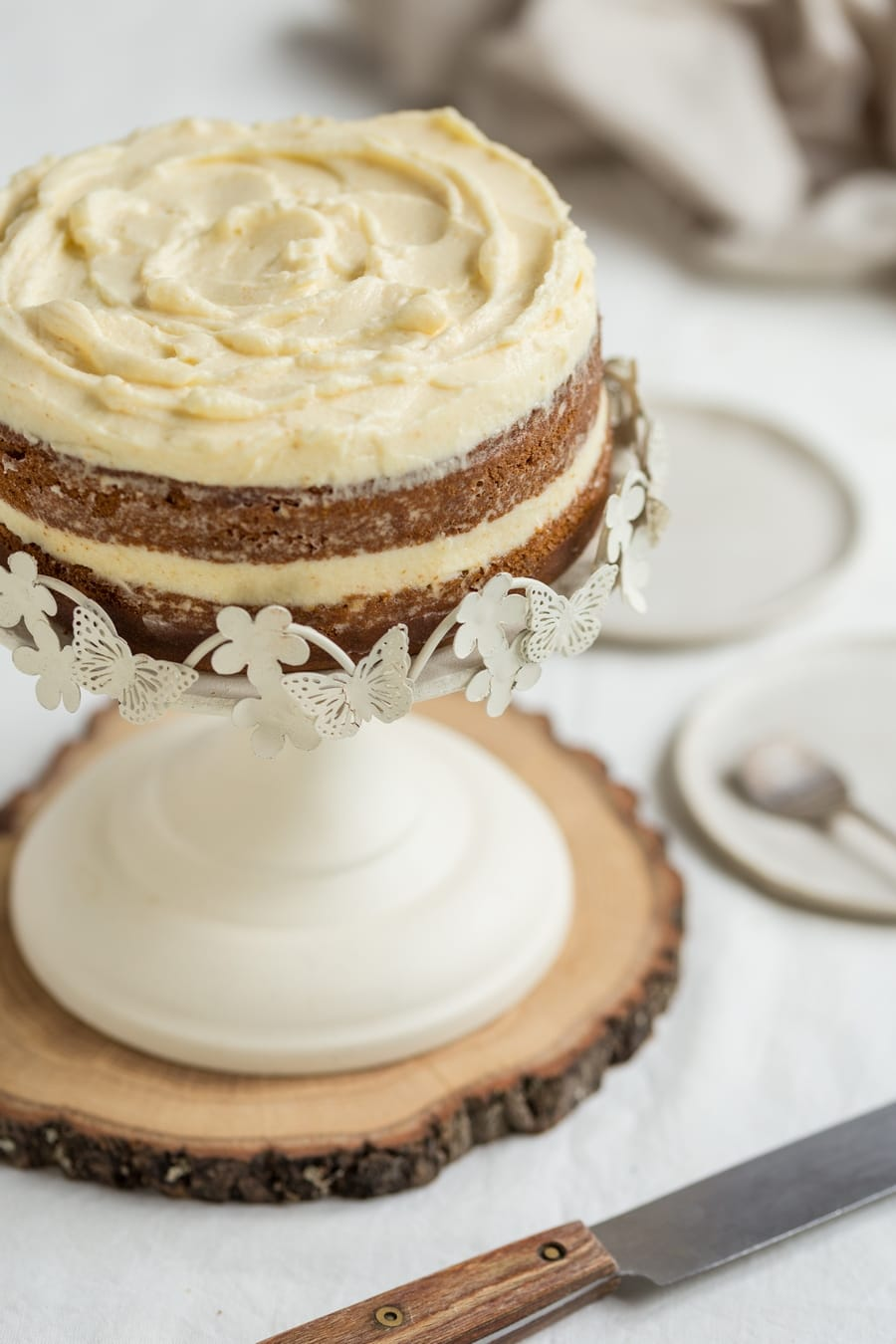 Detail of top ruffles of sweet potato cake with brown butter frosting.