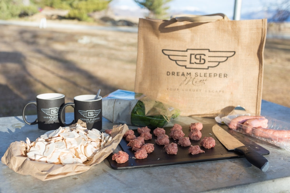 Dream Sleeper Mini campervan kitchen amenities and food.