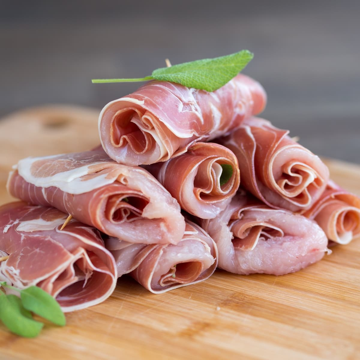Rolled up raw chicken prosciutto involtini.