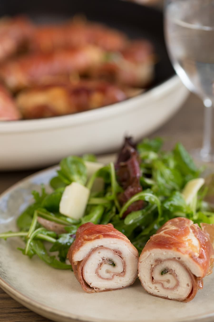 Chicken involtini serving suggestion: with a green salad and parmesan flakes.