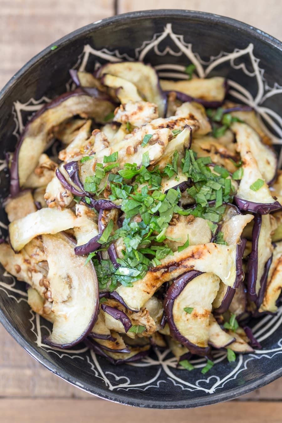 Grilled eggplant salad with olive oil and fresh mint.