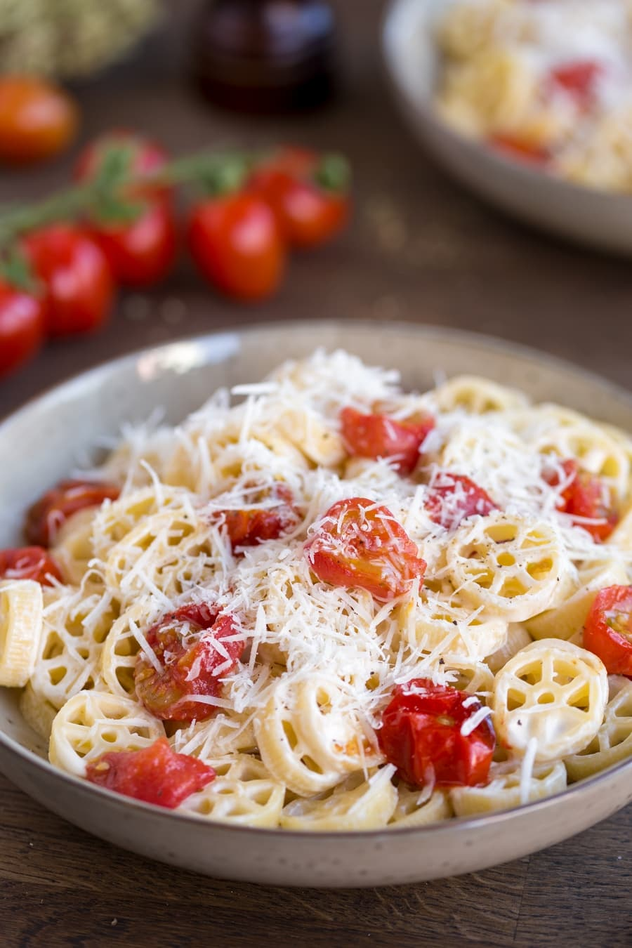 Closeup of roasted cherry tomato pasta.