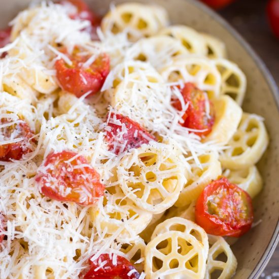 Oven-roasted cherry tomato pasta closeup.