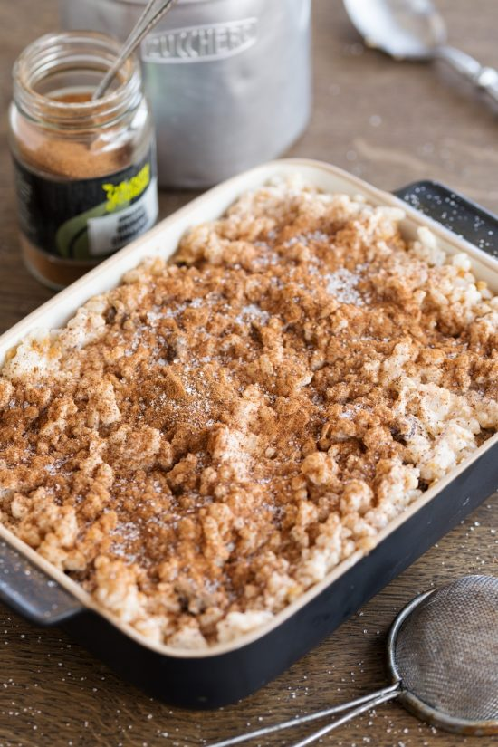 Baked rice with apples casserole sprinkled with ground cinnamon and sugar.