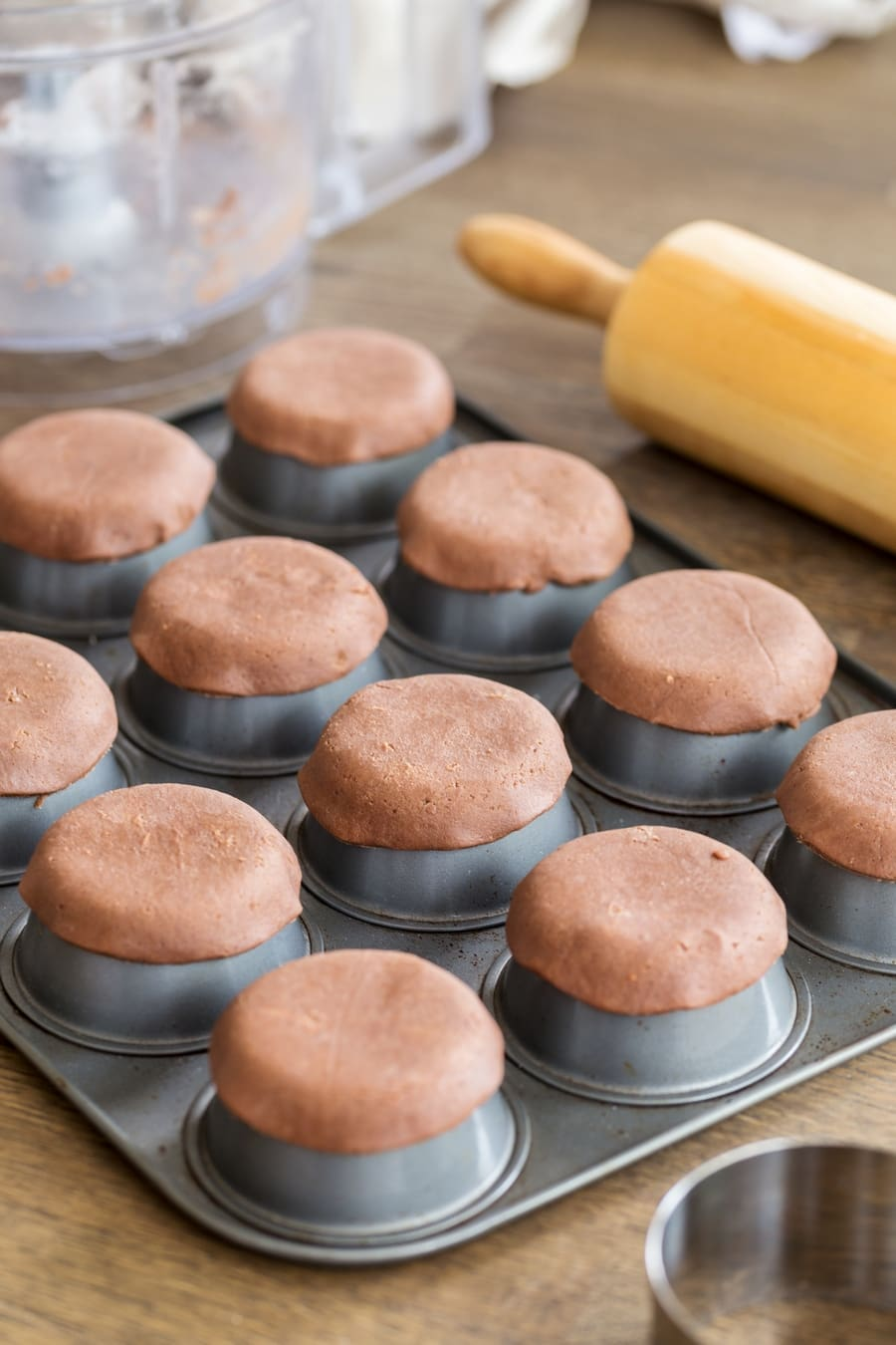 Shortcrust pastry circles baked over upside down muffin tin to make small shortcrust shells.