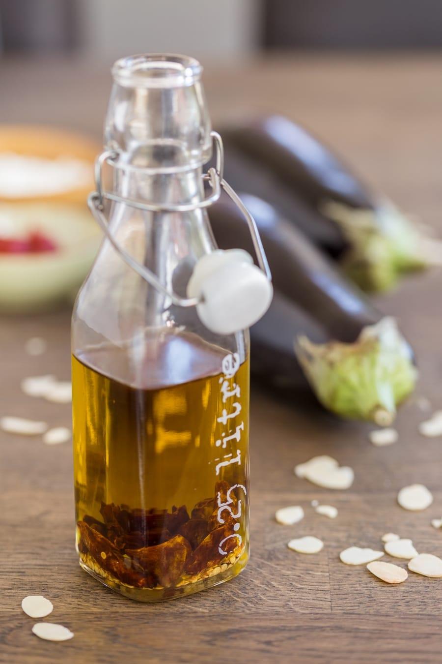 Italian chili oil in a glass bottle.