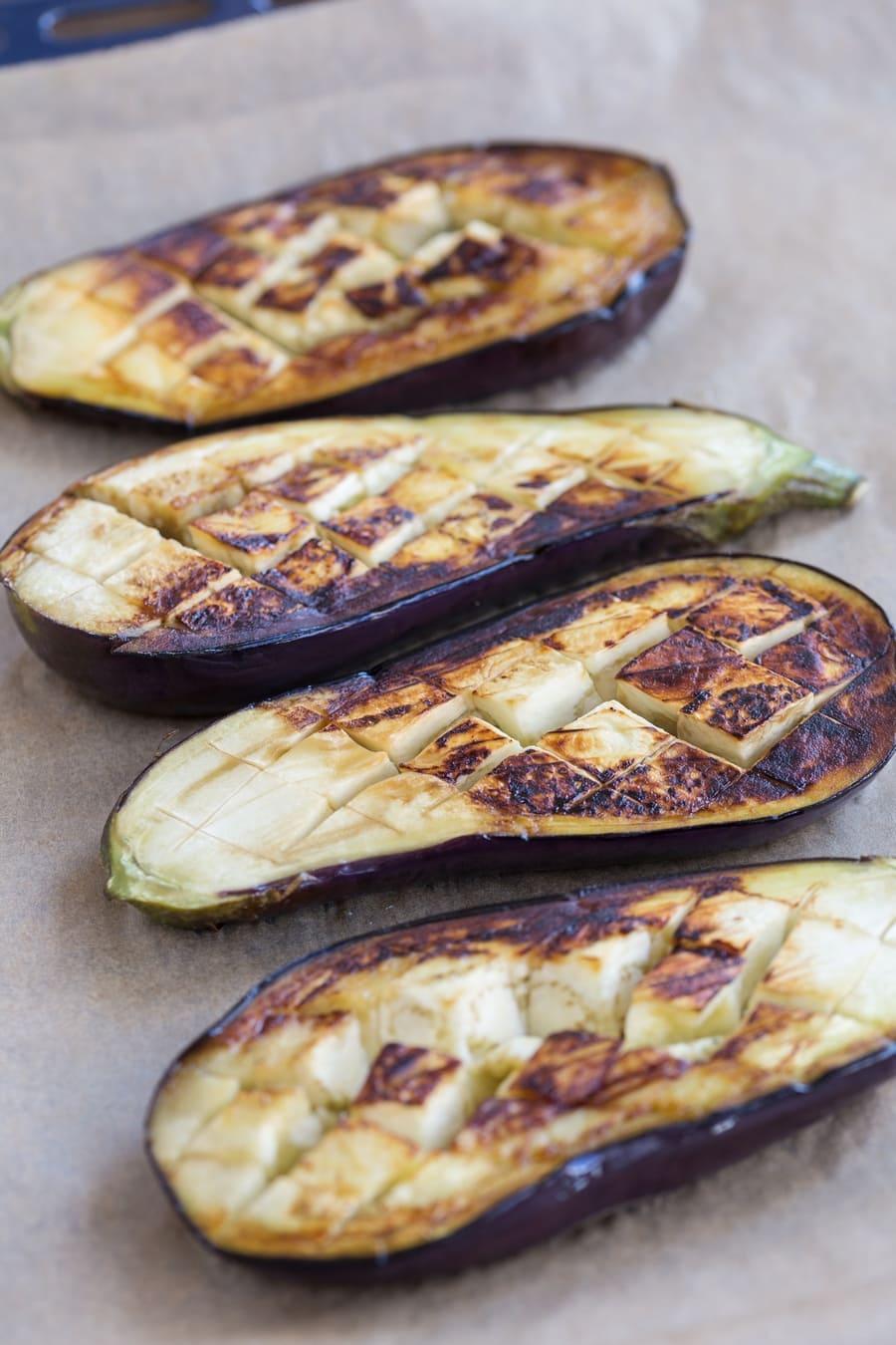 Blackened eggplants on an oven tray.