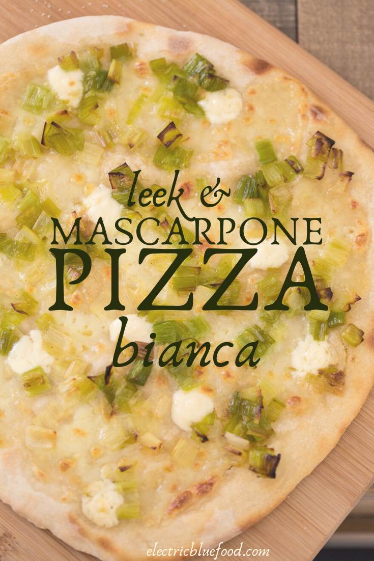 Leek mascarpone pizza bianca: an unusual pizza topping for a delicious homemade pizza. No tomato sauce but good olive oil and puddles of melted mascarpone cheese that perfectly pair with sautéed leeks with white pepper.