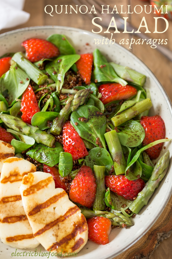 Asparagus and halloumi salad with strawberries and quinoa. A bed of green leaves and red quinoa topped with fresh strawberries, steamed asparagus and grilled halloumi. All seasoned with a simple balsamico vinaigrette. A healthy and balanced summer lunch.