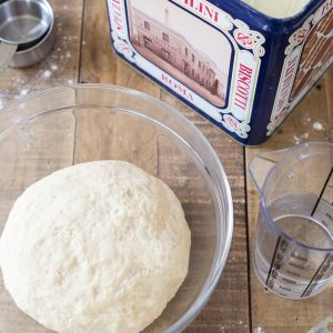 Pizza dough ball, water, flour.
