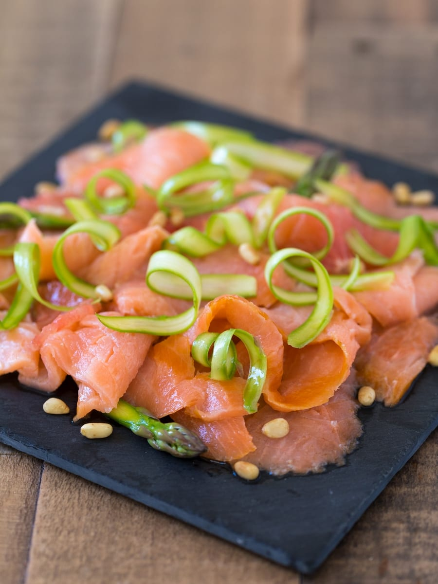 Smoked salmon carpaccio with shaved asparagus and grapefruit.