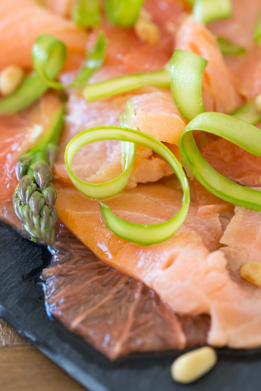 Detail of shaved asparagus on salmon carpaccio.