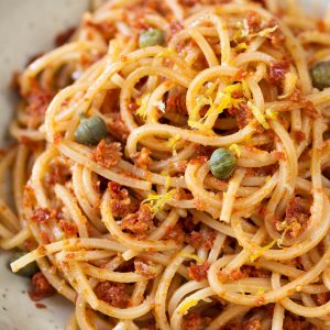 Spaghetti alla chitarra with red pesto, capers and lemon zest.