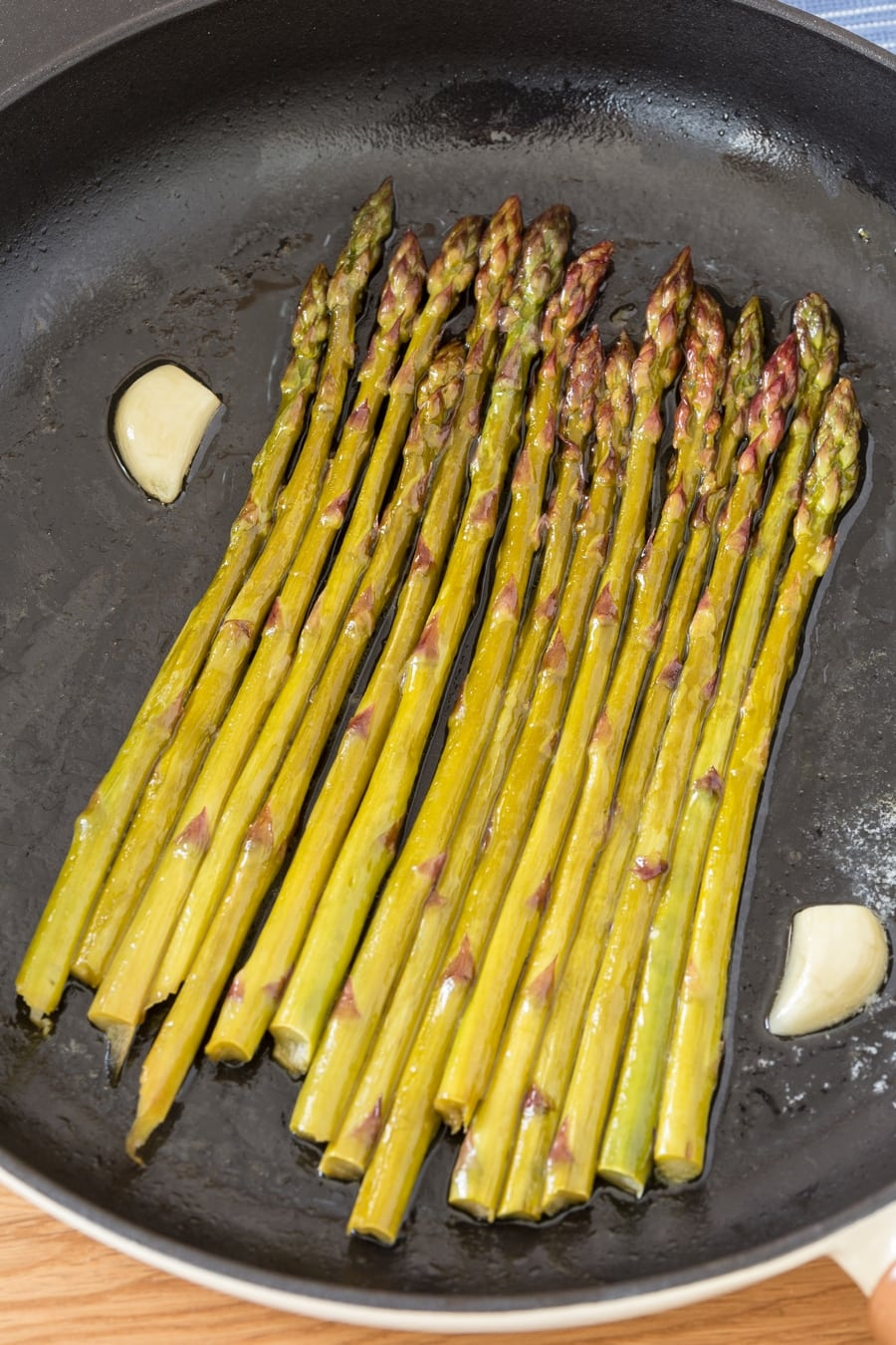White wine asparagus in cast iron skillet.