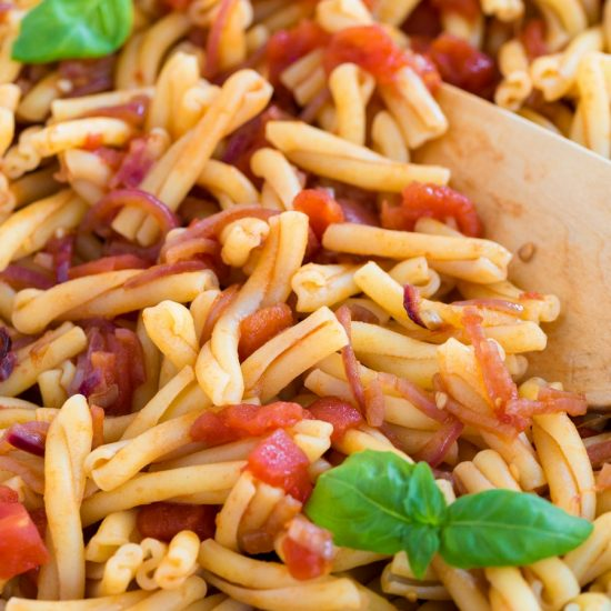 Closeup of tomato pasta with balsamico onion sauce.