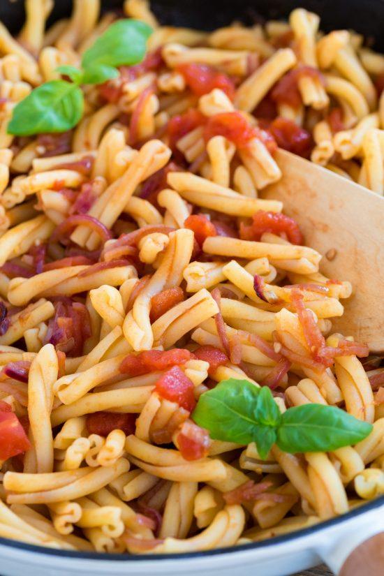 Closeup of tomato pasta with balsamico onion sauce.