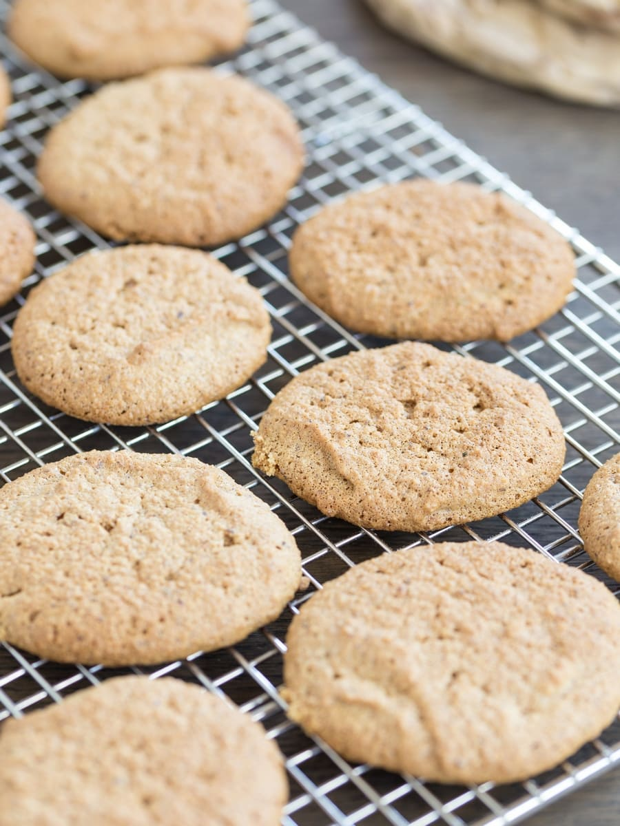 Baked honey hazelnut meringue cookies on a cooling rack.
