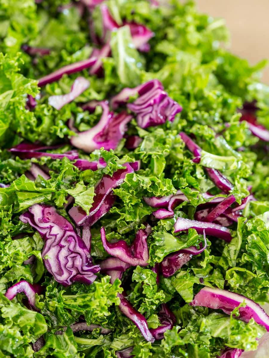 Chopped red cabbage and kale in a bowl.