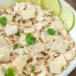 Raw mushroom salad with lime cilantro and parmigiano flakes.